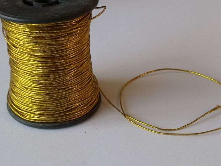 GOLD FINE CORD - ONE METRE      Gold coloured fine cord, thickness 0.5mm. Use for decorative hangings - a fine cord with a metallic sheen. If you order multiples of one metre, it will be left in one piece (not cut into one metre lengths).