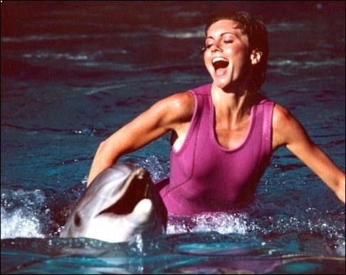 Olivia Newton John swimming with dolphins in The Promise. A Dophin Song video