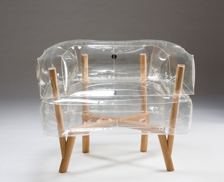 An inflatable chair with a wooden base that rethinks the entire idea of flat-packed furniture with new materials, making it look cool and comfortable.