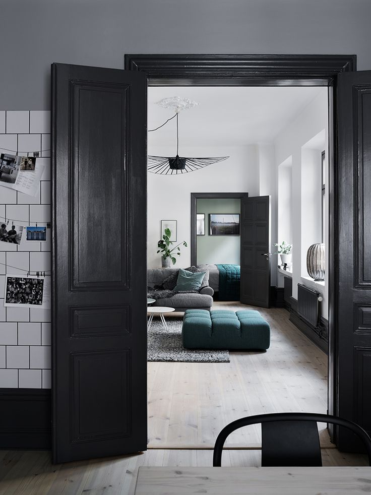 Moody nordic apartment evoking a feeling of hygge, the Danish word for creating a warm and cozy atmosphere.