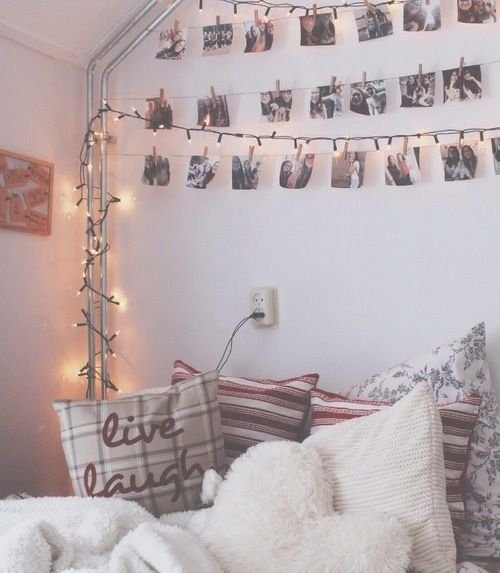 Hanging pictures and stringing lights in a beige or white colored room with a couple of colorful accents would make the perfect room to come home to after school and just relax and take in the simplicity and beauty of LIFE......All because of the design of the room.