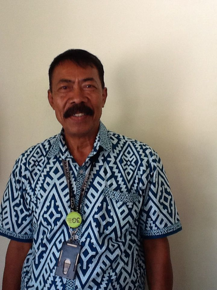 He's name is Sudirman.he is 55 years old.he is the security of cita hati west campus surabaya by: max 6a
