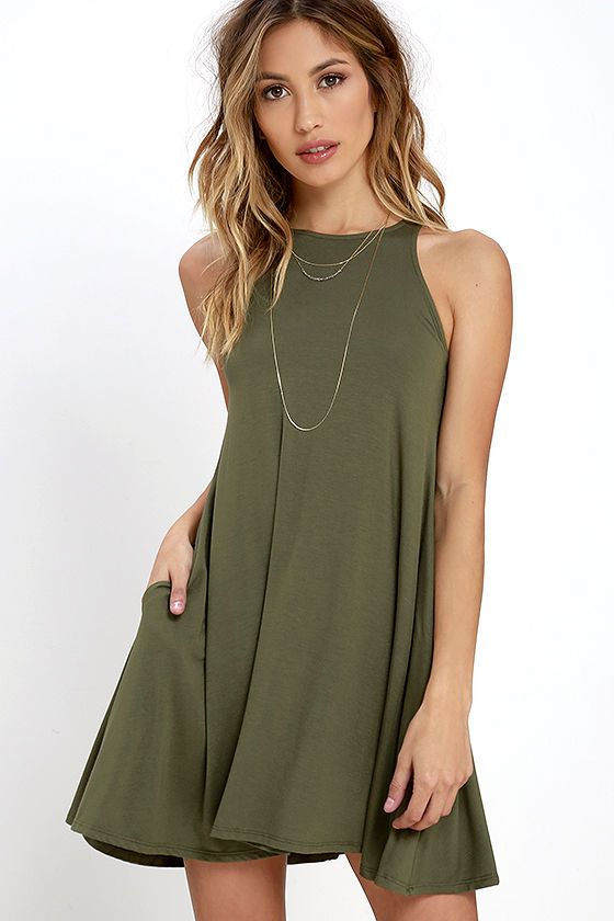 You'll attract good vibes like bees to pollen in the Tupelo Honey Olive Green Dress! Olive green jersey knit is as soft-as-can-be across a high, rounded neckline and wide arm openings. Sleeveless bodice flows down in a flattering trapeze shape (with side-seam pockets).