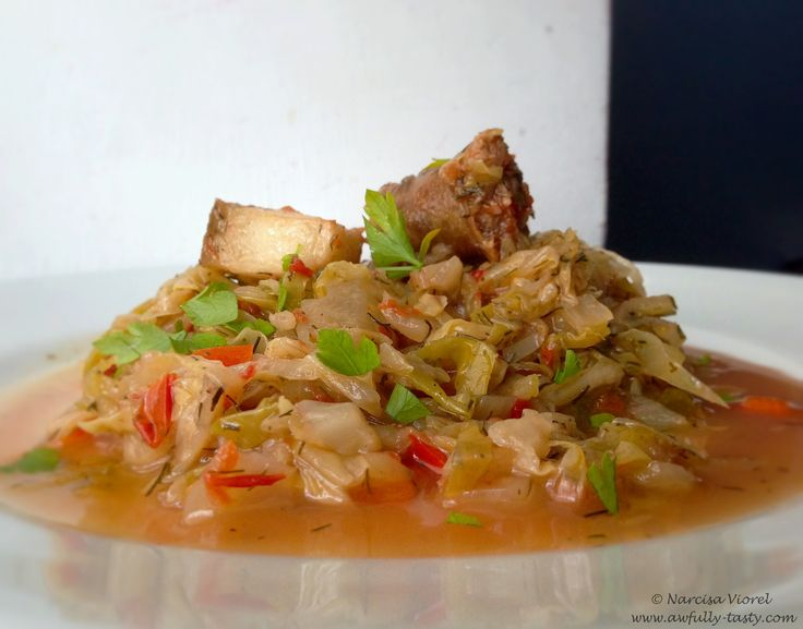 Varza calita cu sunca si carnati de casa.  Cabbage with traditional homemade ham and sausages.