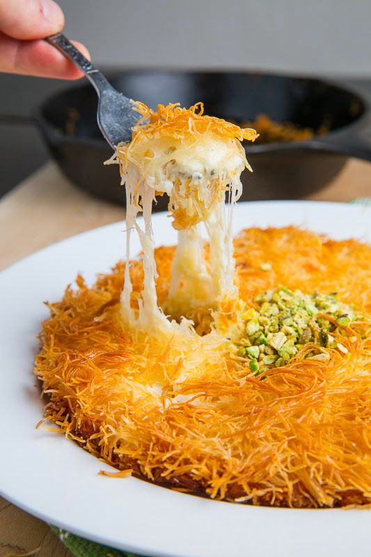 Künefe (Sweet Cheese Pastry)  ingredients 1/2 pound shredded phyllo (called: kataifi or kunefe), thawed as directed on package 1/2 cup unsalted butter, melted 2 cups mozzarella, shredded 2 cups feta (soaked in water for an hour) or goat cheese, crumbled 1/2 cup simple syrup or 1/4 cup apple and/or pear sauce