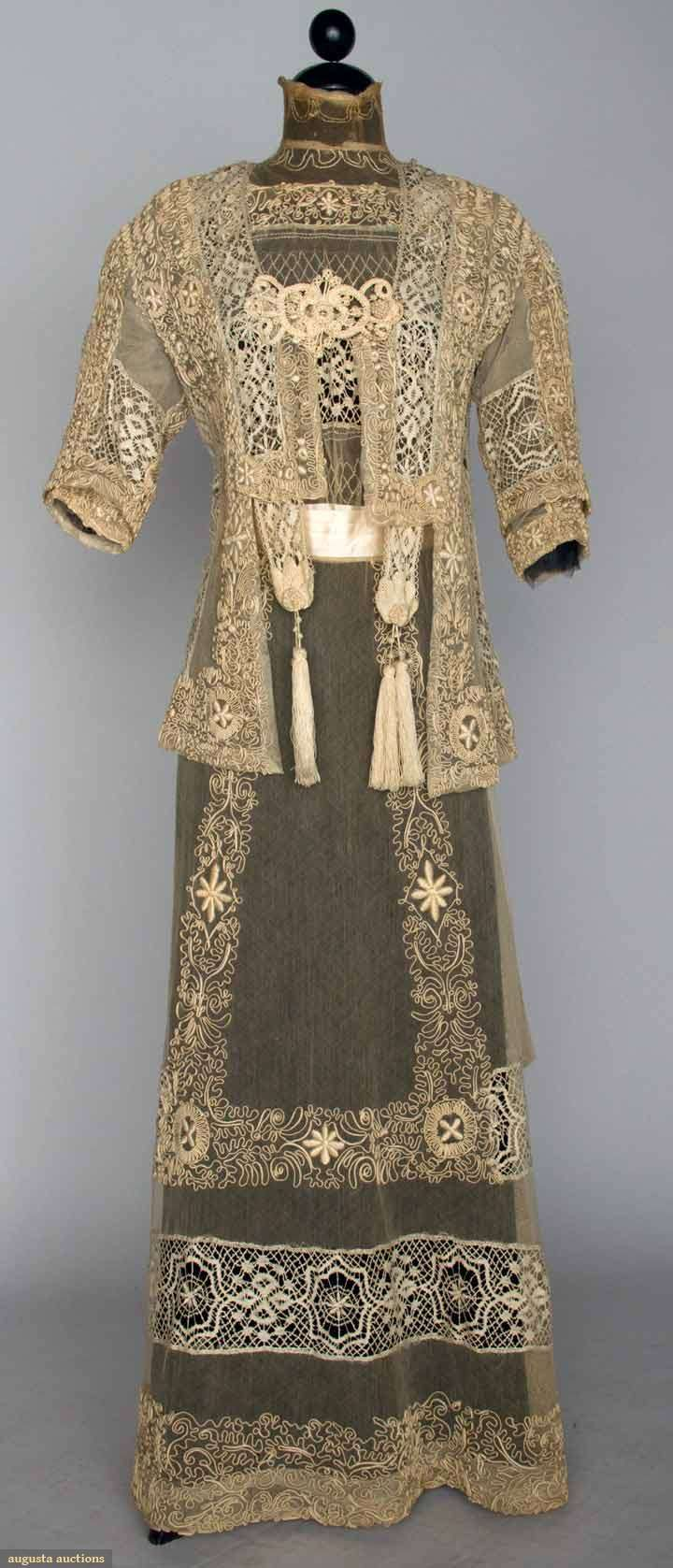 Circa 1914 lace tea gown and jacket: cream cotton net w/soutache, bobbin lace, and embroidery; hip length jacket w/cut away front