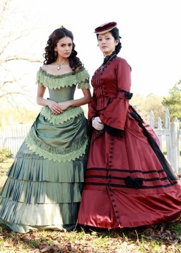 I like the sleeves of the red dress and the shape of the skirts on both for the Woman in Black's dress.