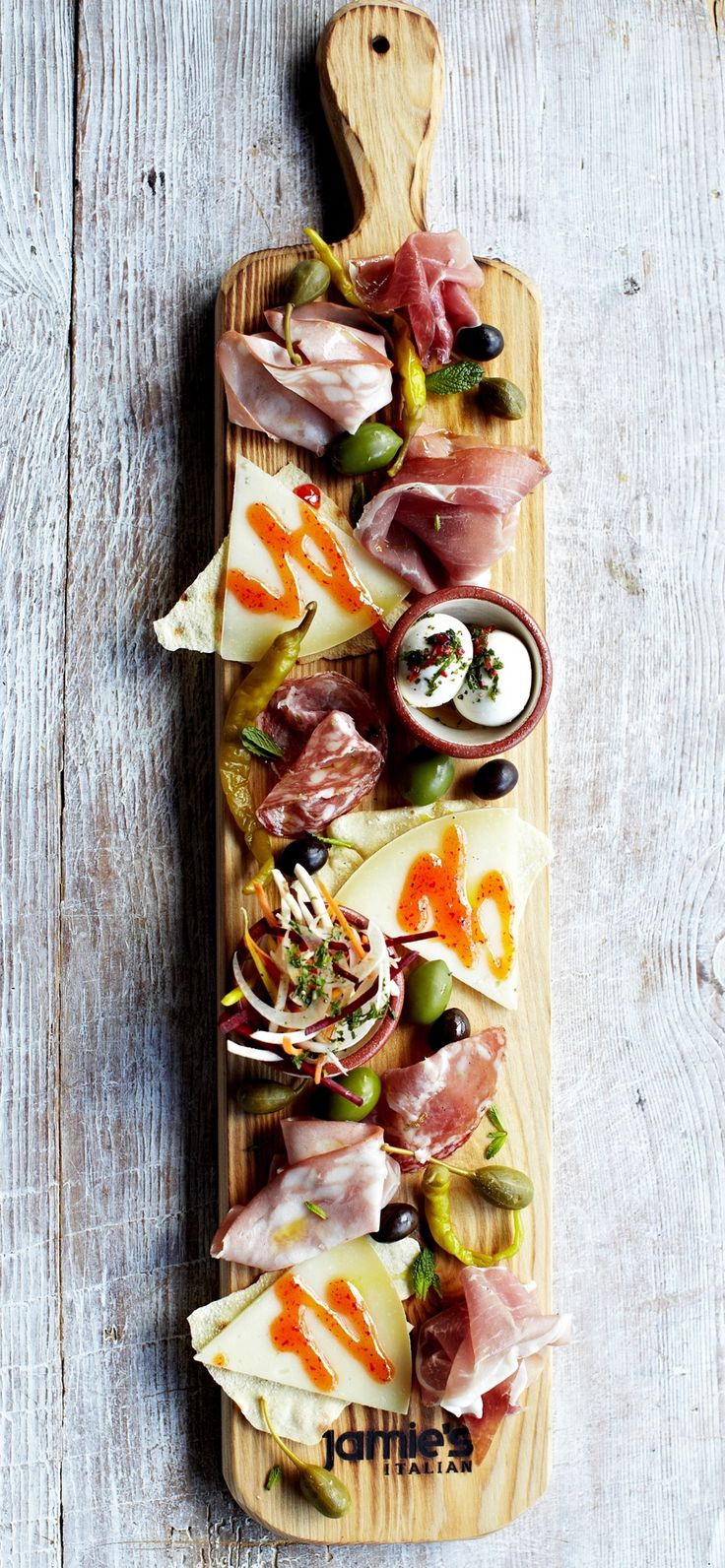The famous planks at Jamie's Italian. Served with your favorite cured meats, Italian cheeses, and pickled vegetables.