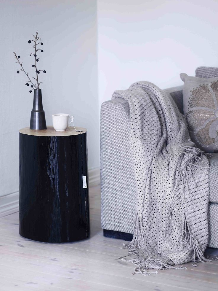 Use a black stumps as a small sofa table!