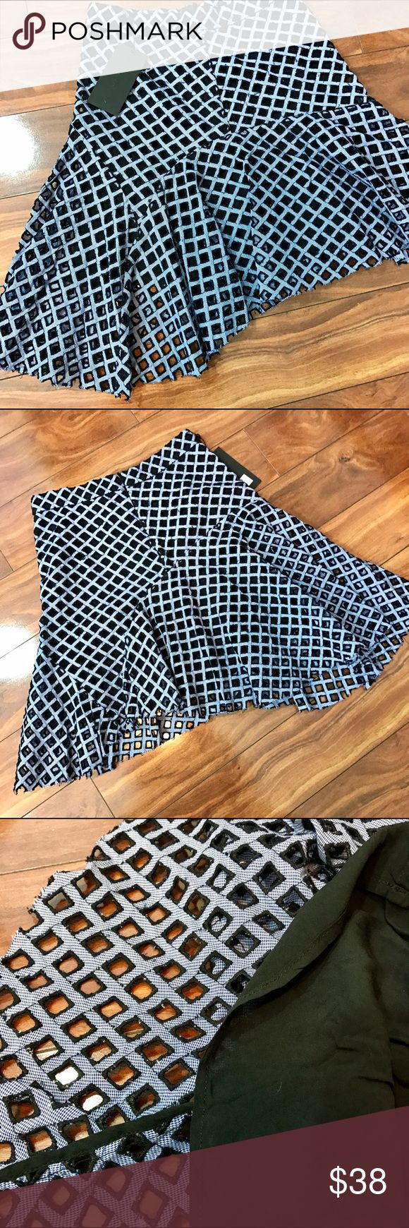 Kendall & Kylie asymmetrical skirt. NWT Very cool K&K open weave skirt is lined, with back zipper. Asymmetrical hem line is the wow factor. Tag says blue but I think it looks more lavender and black. Smoke free home Kendall & Kylie Skirts Midi