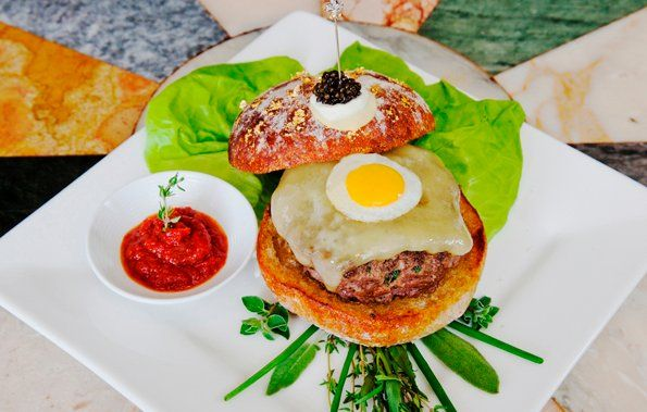 Serendipity 3 restaurant just unveiled the world's most expensive burger: Le Burger sells for $295.00 (£186.52).