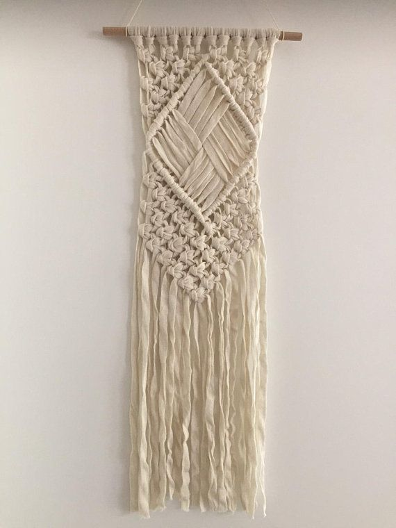 This cream-white macramé wall hanger is made of 100% cotton