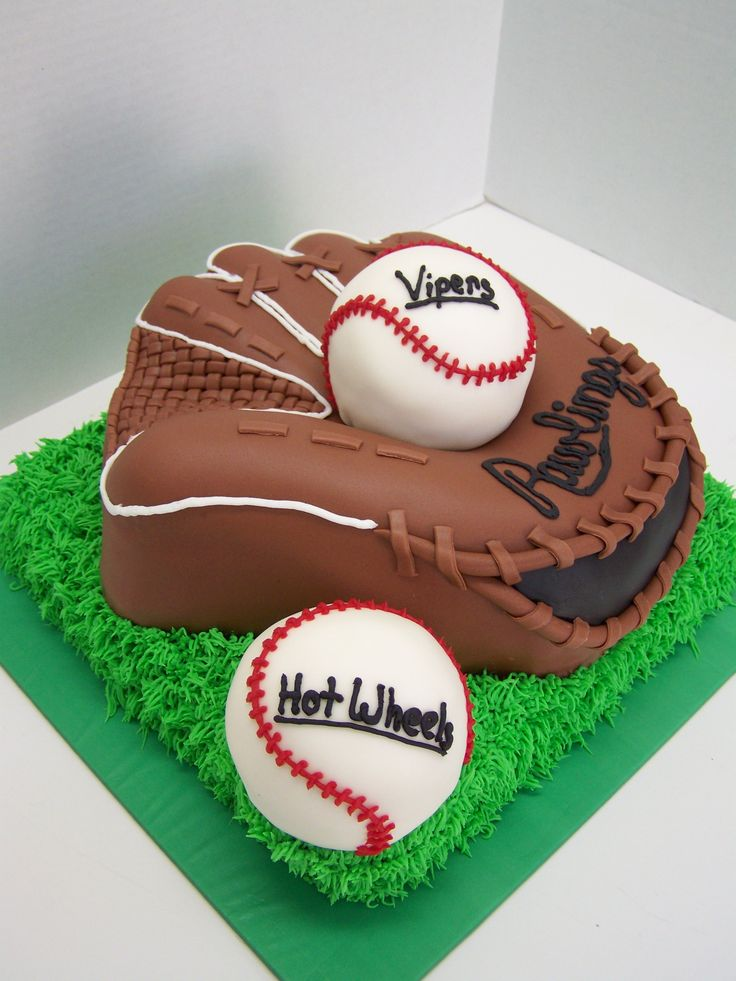 Ball & Glove - Glove was made with a shaped pan & built up & carved from there. Baseballs were both cake covered in fondant.