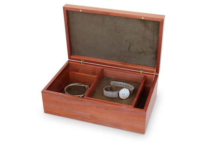This larger model of the Tamar Jewellery-Box-with-Tray shares with its compact version all the characteristic features of the Tamar range; clean, minimalist lines with all the focus on the lid's decorative timber panel, in this case Tasmanian Tiger Myrtle. The characteristic black tiger stripes are trails left through the timber by a naturally occurring fungus which thrives in the wet Tasmanian forests. With just a discreet finger groove for opening the box, small magnets for secure closing…