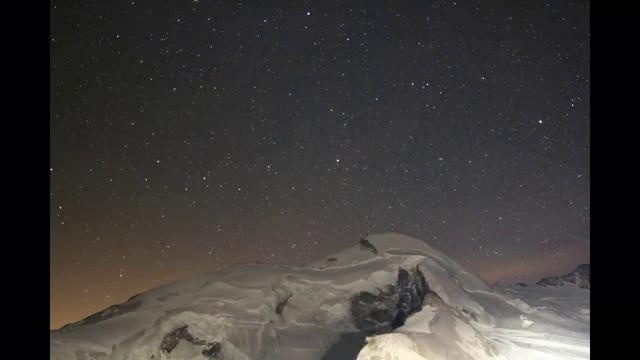Geostationary satellites in the Swiss Alps by Michael Kunze. The twinkling stars in the sky are fixed geostationary satellites. The video was taken on the 3500-meter high Mittelallalin in Switzerland Saas-Fee.