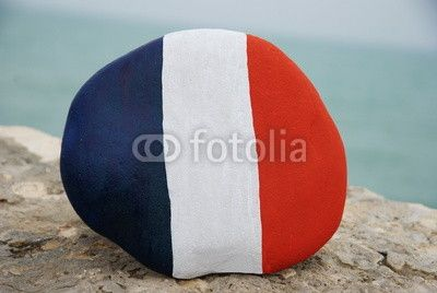 Flag of France on a stone with sea background