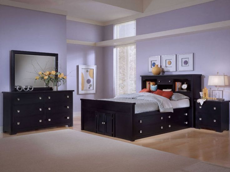 purple painted wall black bed frame black headboard with drawers bedroom wall mirror sets laminate wood flooring