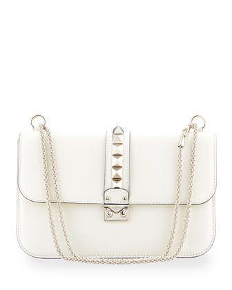 Rockstud-Trim Lock Flap Bag, Ivory by Valentino at Bergdorf Goodman.