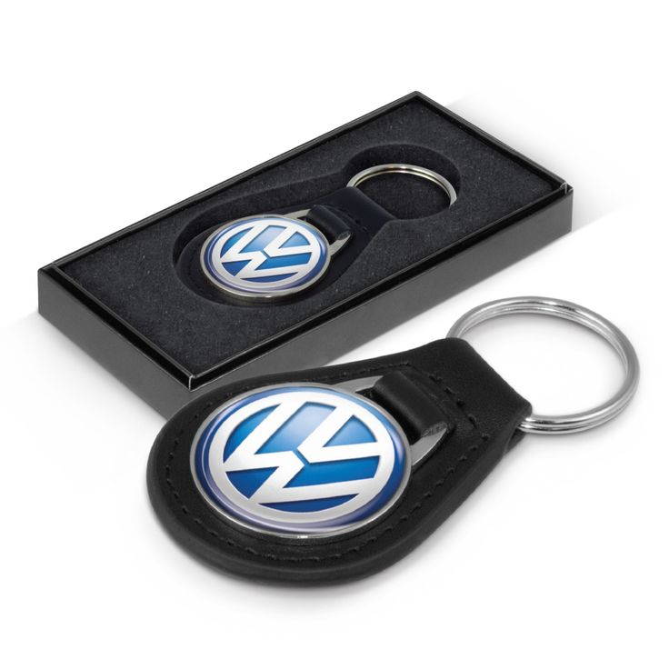 Genuine leather key ring with a round metal plate for branding with a resin coated finish. It is nicely presented in a Black gift box.