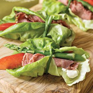 Beef & Asparagus Bundles with Butter Lettuce & Garlic Herb Cream Cheese. Delicious finger food appetizer. Sprinkle with a little sesame seeds too perhaps...