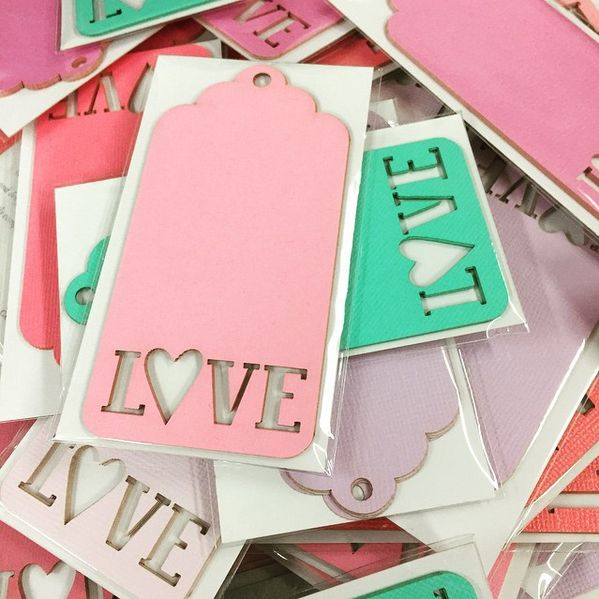 If love is in the air, then show it with these bright and colourful laser cut swing tags. These are made right here in store and the best part? We can do ANY colour and ANY word! www.thepaperempire.com.au