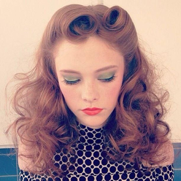Victory rolls and soft green eyelids.