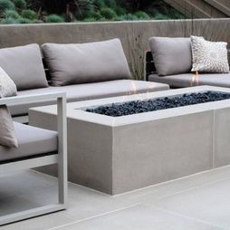 outdoor fireplace - or seating along stacked wall with a rectangle fire pit