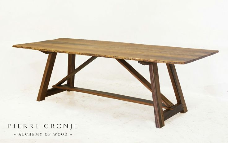 A Pierre Cronje Dining Table in Ironwood with a waney (natural) edge.