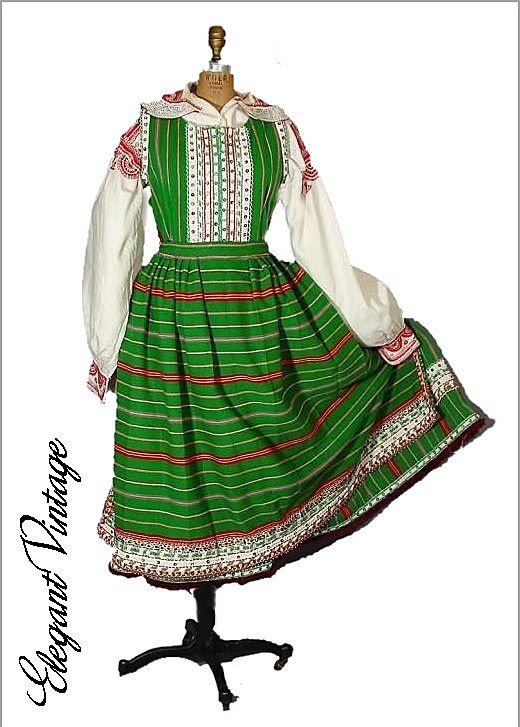 Polish Traditional Dress from Kurpie region. Just like one performed in by the Kujawiaki troupe. In fact, I found that when coming out of a spin, the hem of the dress, heavily encrusted with beaded details, kept on going an extra half turn or so!