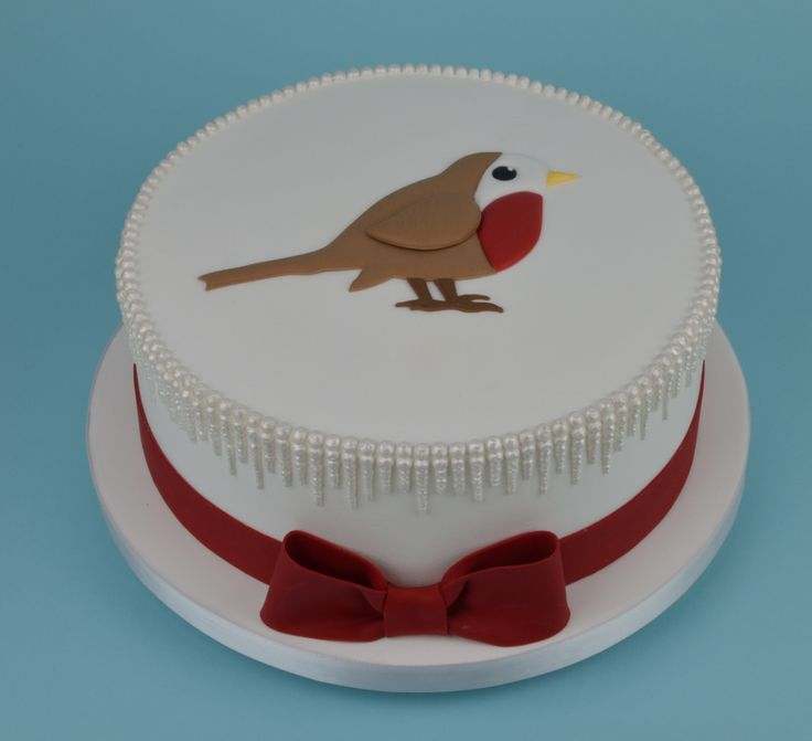 Royal iced Christmas cake with a run-out robin made for DK books.