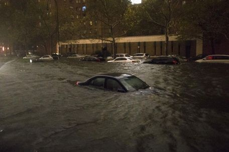 Superstorm Sandy struck NE coast of the US causing massive damages and loss of lives. This picture is of a vehicle submerged on 14th Street near the Consolidated Edison power plant, Monday, Oct. 29, 2012, in New York.