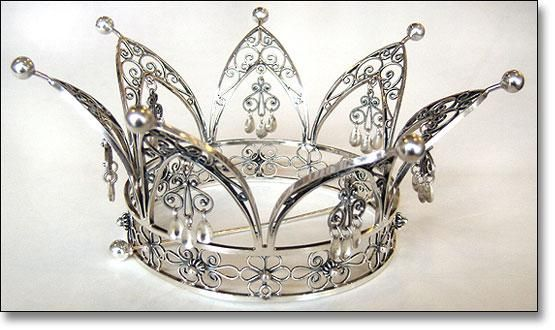 The wedding crown has long been a lovely and integral part of the Scandinavian bridal attire and a treasured family heirloom. This beautiful crown, made by hand in Norway, is offered in white silver with gold spoons (shown) or slightly darker silver with silver spoons