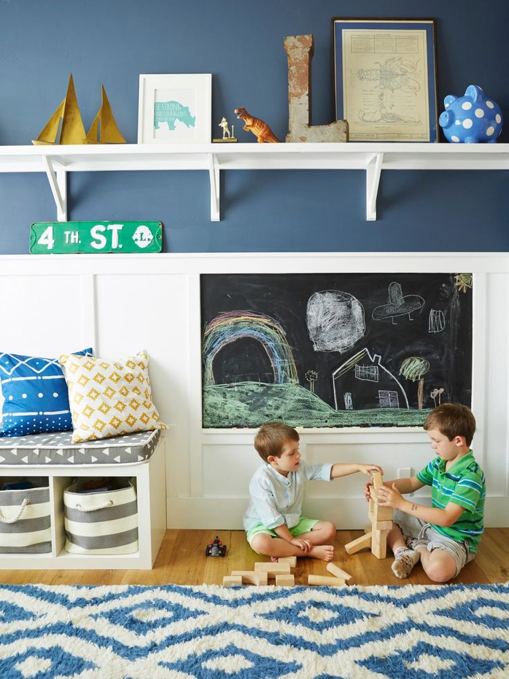 The Hand-Me-Down-House | HGTV, navy blue walls, shelves, toy storage, geometric rug, chalkboard wall, board and batten wall