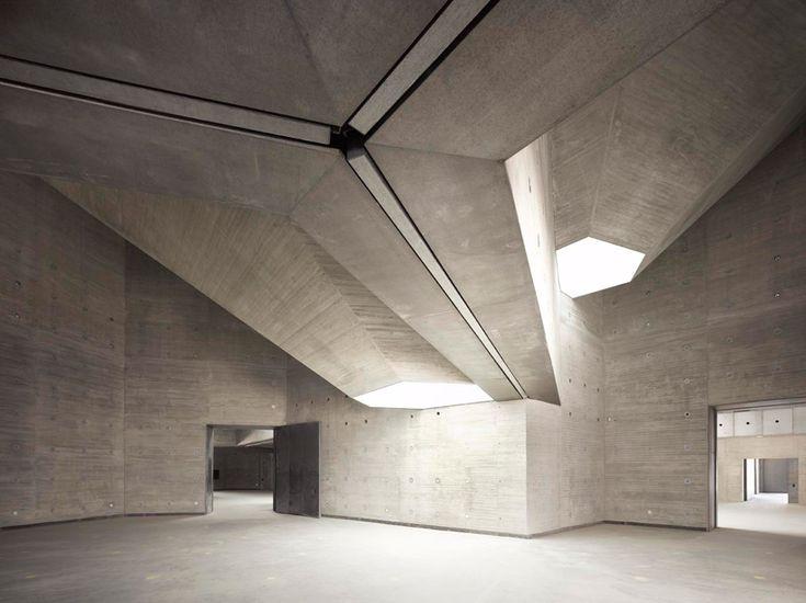 contemporary art center by nieto sobejano - interior gallery space illuminated from the skylights above
