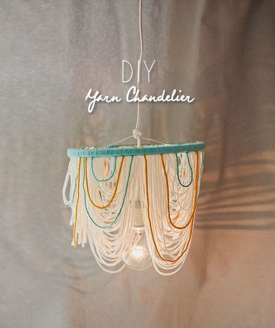 DIY Yarn Chandelier made by Your Cloud Parade. Guaranteed to add a little cozy to any room.