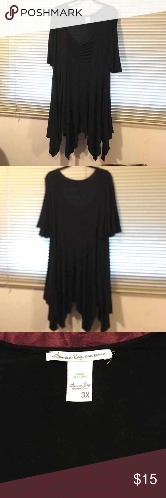 Tunic with zig zag hem. Brand new never worn (too big) black long tunic with uneven hem. Bought from Macy's, true to size 3X. Would look great with leggings and boots. Cute string tie in back. American Rag Tops Tunics
