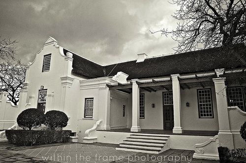 #CapeDutchHouse with end gables and trellised front porch. Nice wall details. Beautiful South African architecture. Inspire me! Photo byWithinTheFramePhotography
