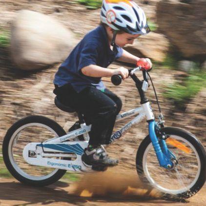 Boy riding his E-250 Kids Bike through the mud on the family farm.  So much fun!