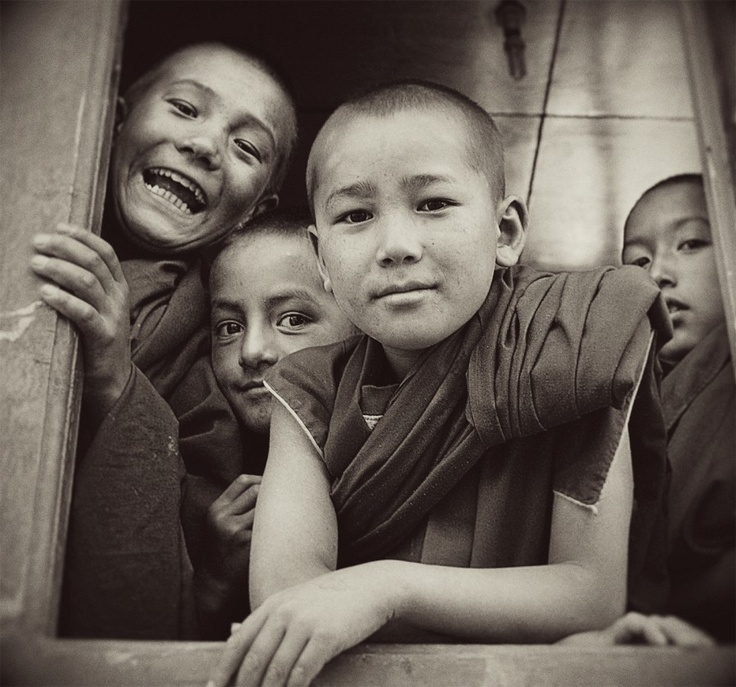A photo captured of the inquisitive, over-joyed, little monks who chose to bunk a class in progress followed visitors around while they walked the village of Likir in Ladakh, India.