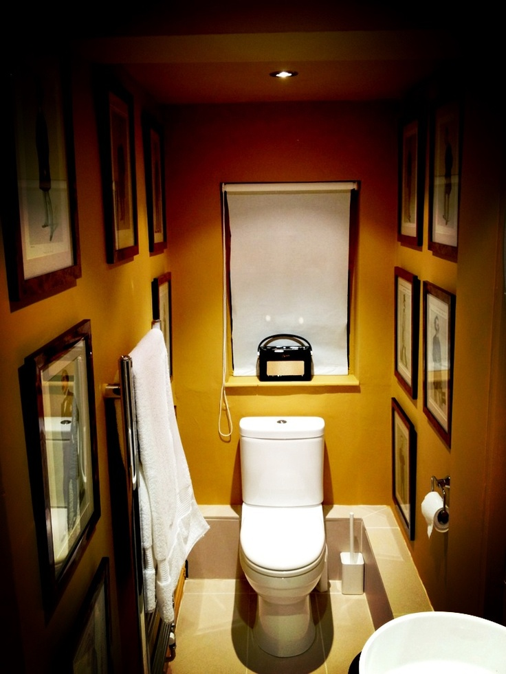 Farrow & Ball India Yellow with Vanity Fair 'Men of the Day' prints in walnut frames. James Bailey