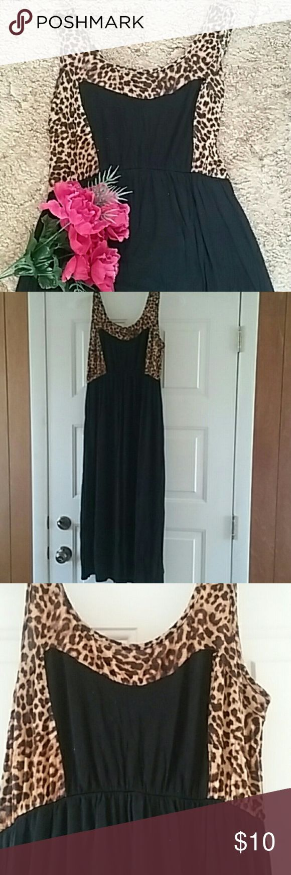 Leopard Maxi dress Leopard and black color block maxi dress. Is actually a maternity dress, but looks great used as a regular dress as well! Very light weight and flowy material. ping maternity Dresses Maxi