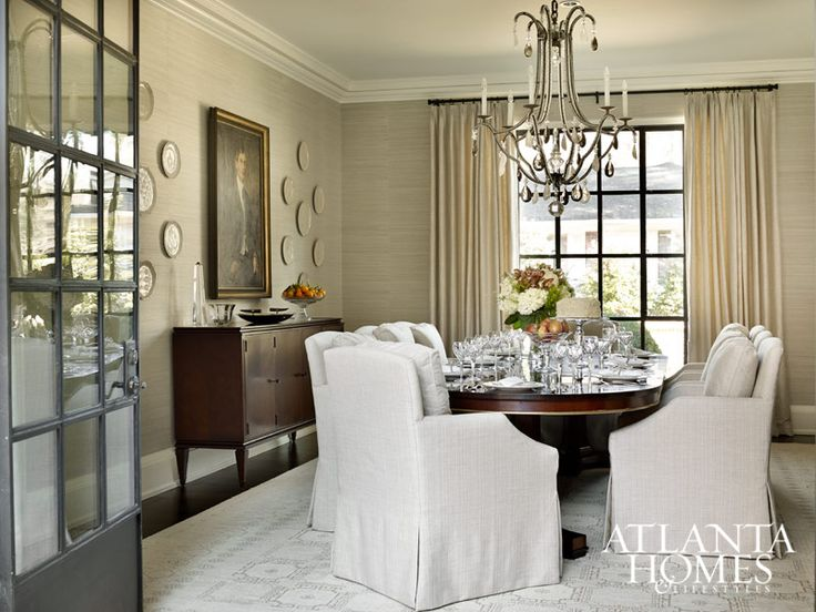 in this tuxedo park dining room cushy chairs sidle up to a more formal hickory chair table while a dennis leen crystal drop chandelier hangs overhead