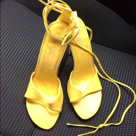 $5 FLASH FRIDAY Yellow strappy heels New. Strappy heels. Straps wrap around leg. Shoes Heels