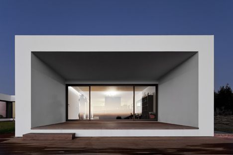 This hill-top house by Portuguese architect Jorge Graca Costa was designed for a professional surfer and his family. More via dezeen.com.