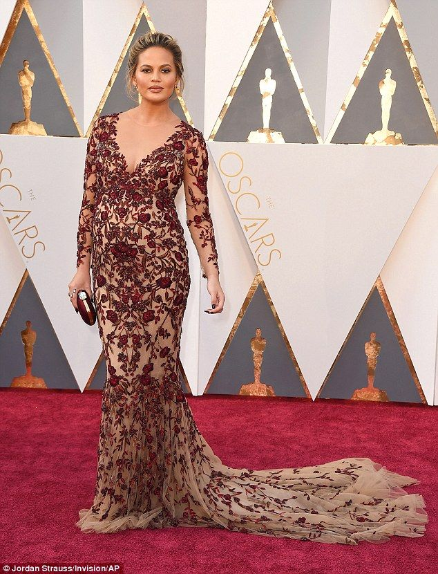 Oh mama: Chrissy Teigen caught the eye in a heavily embellished red and flesh-toned gown a...