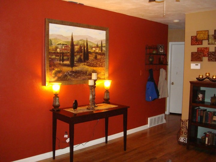 added a new painting and lamps burnt orange is the wall color interior design room i have. Black Bedroom Furniture Sets. Home Design Ideas