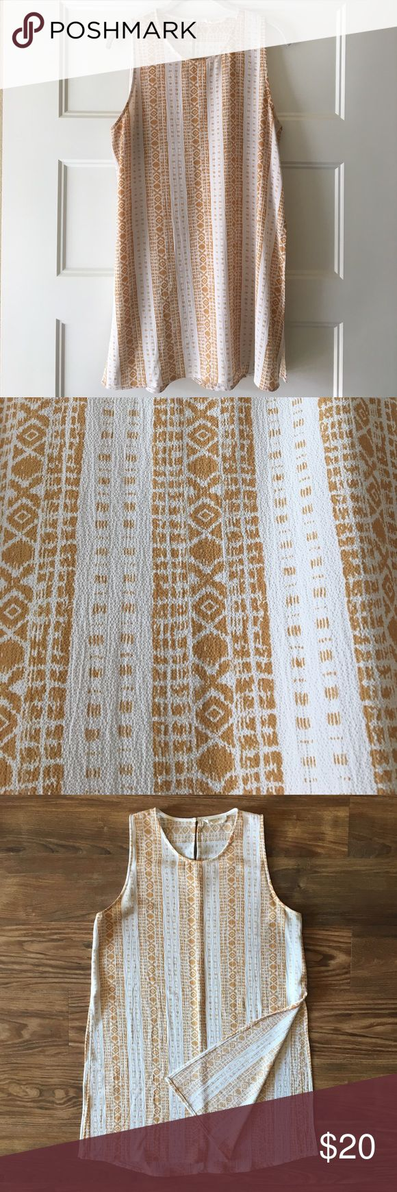 """Sophie Rue Aztec Print Tunic in Mustard Yellow Beautiful print, flattering cut, excellent tunic! 32"""" length and 15"""" slits up each side. Perfect to layer with shorts or leggings in any season. Any other measurements happily provided upon request. Tops Tunics"""