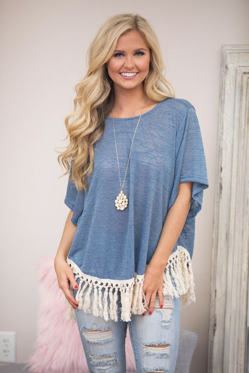 From dancing the night away to enjoying a backyard party, this gorgeous tassel blouse is sure to make your heart swoon!From the soft faded blue material to the cream tassels along the bottom, we just