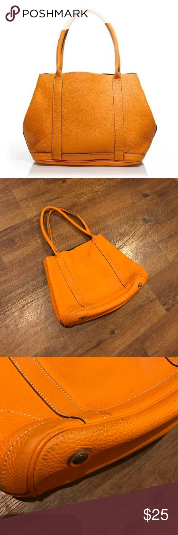J.Crew Uptown Tote J.Crew Uptown tote in pumpkin. 100% leather. Interior pockets. Can be adjusted to a tote or an a line shape. From 2008. In used condition. Some scuffs on bottom of purse. Priced to sell immediately. J. Crew Bags