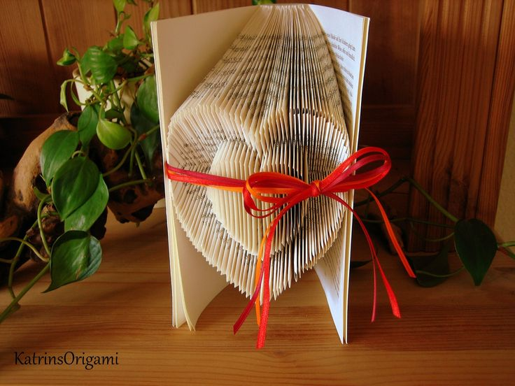 Book folding Art - Origami Sculpture - Lots of YouTube book folding videos.